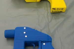 Seized plastic handguns which were created using 3D printing technology are displayed at Kanagawa police station in Yokohama, south of Tokyo, in this photo taken by Kyodo May 8, 2014. Yoshimoto Imura became the first man to be arrested in Japan for illegal possession of two guns he created himself using 3D printing technology, Japanese media said on Thursday. The 27-year-old, a college employee in the city of Kawasaki, was arrested after police found video online posted by Imura claiming to have produced his own guns. Gun possession is strictly regulated in Japan. Police raided Imura's home and found five guns, two of which could fire real bullets, Japanese media said. Mandatory credit REUTERS/Kyodo (JAPAN - Tags: CRIME LAW SCIENCE TECHNOLOGY) ATTENTION EDITORS - THIS IMAGE HAS BEEN SUPPLIED BY A THIRD PARTY. FOR EDITORIAL USE ONLY. NOT FOR SALE FOR MARKETING OR ADVERTISING CAMPAIGNS. MANDATORY CREDIT. JAPAN OUT. NO COMMERCIAL OR EDITORIAL SALES IN JAPAN. THIS PICTURE IS DISTRIBUTED EXACTLY AS RECEIVED BY REUTERS, AS A SERVICE TO CLIENTS