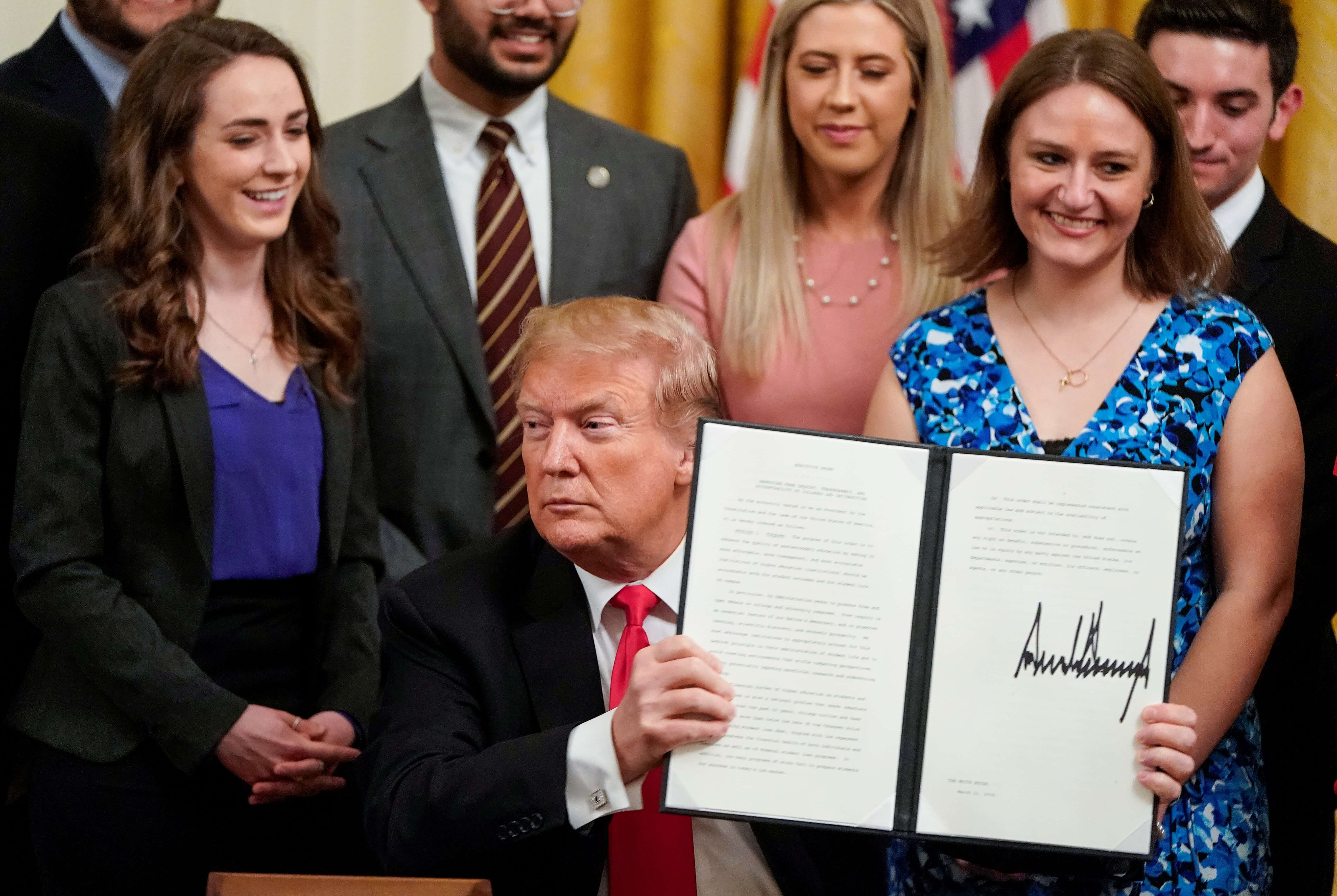 Trump holding signed executive order