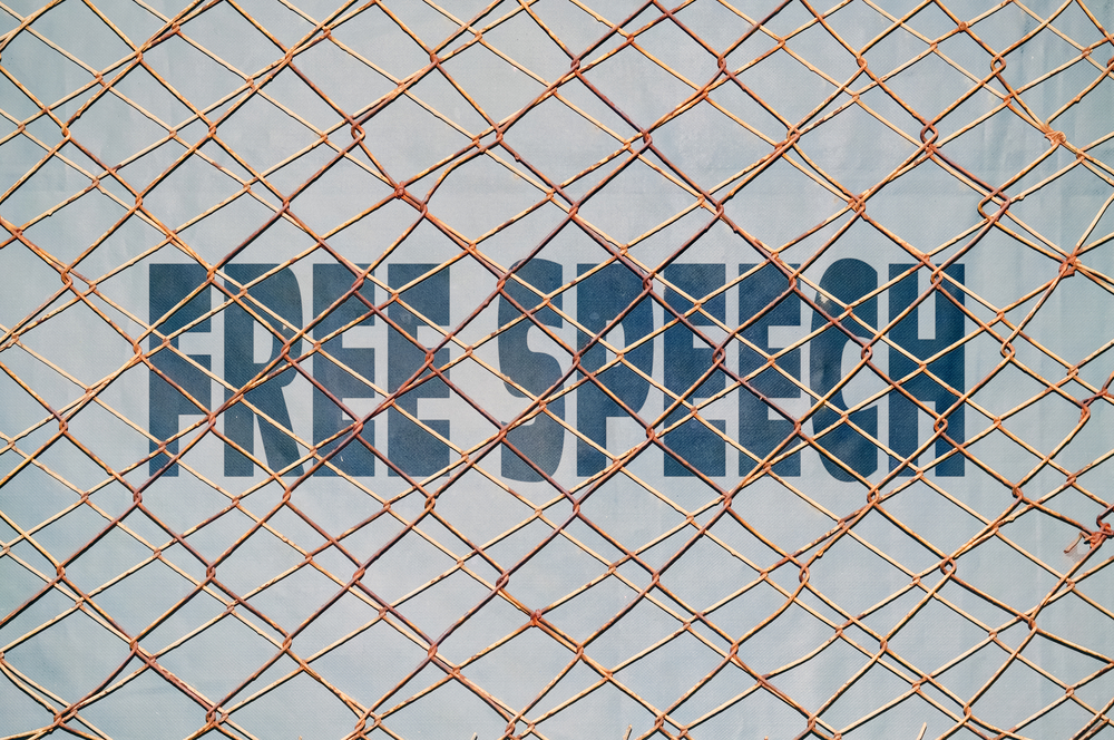 Free Speech behind metal grate